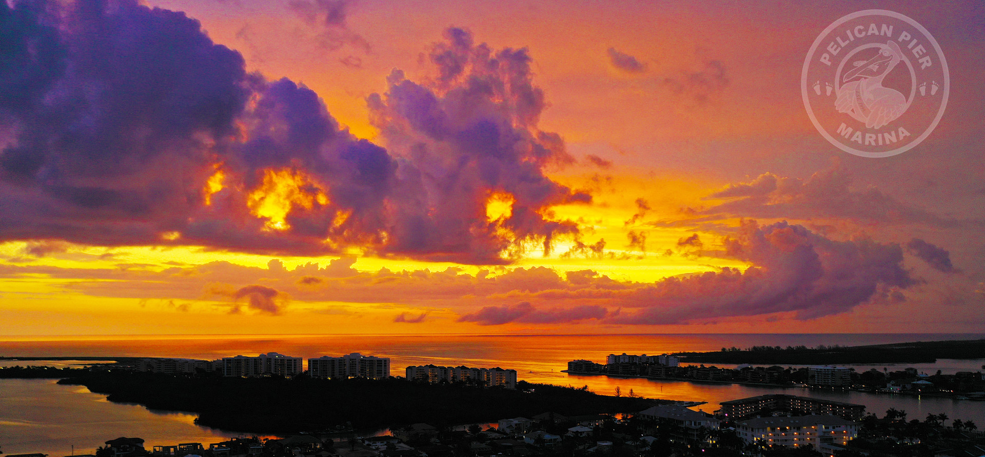 Sunset over the gulf above Pelican Pier Marina