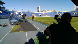 filming at a stadium in russia