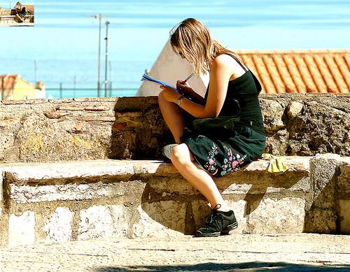 travel blogger writing