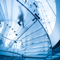 futuristic glass spiral staircase with m