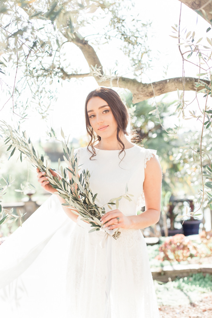 Bride with olive branch bouquet