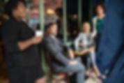 Office workers listening to one of their team members speak