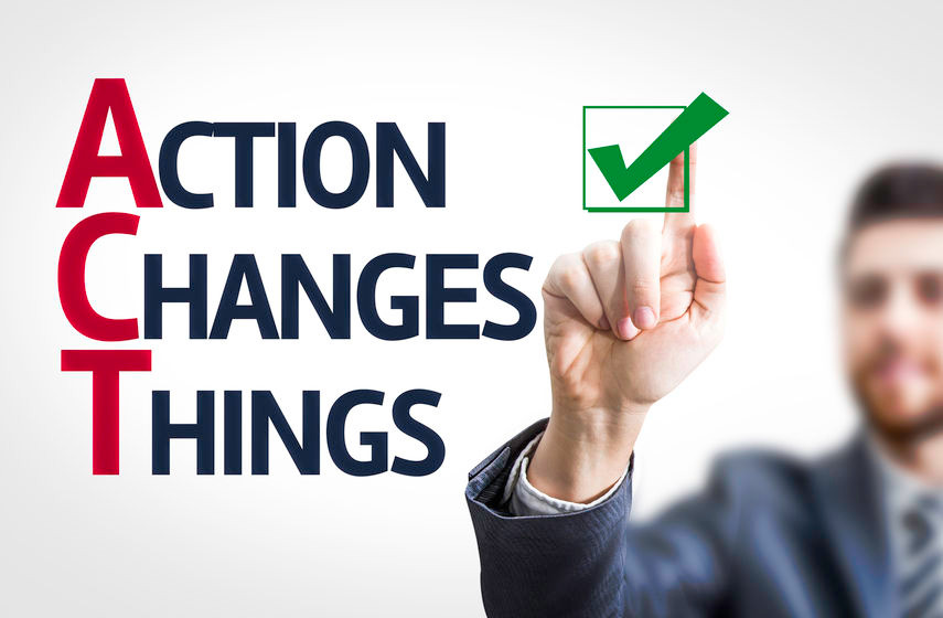Businessman pointing at writing that says action changes things