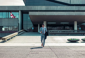 High level CEO walking out of corporate office building