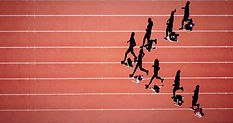 world-class professional athletes running on a track generating momentum