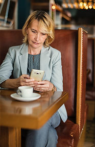 top performer of a corporation texting on her phone