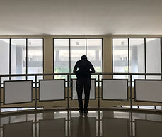 Corporate business leader standing by himself having a self-examination meeting