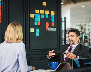 CEO exemplifying responsible leadership by having a conversation with his employee