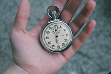 Close up of a pocket watch in the palm of a hand