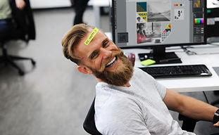 IT tech specialist and company owner sitting in front of his computer