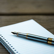 Open notebook with pen on top