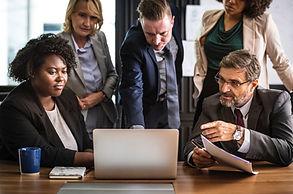 key leadership team having a company meeting