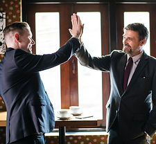 CEO high fives his employee to show his appreciation for his company's team