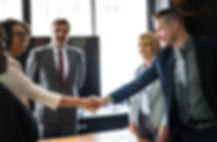 Organizational leaders shaking hands