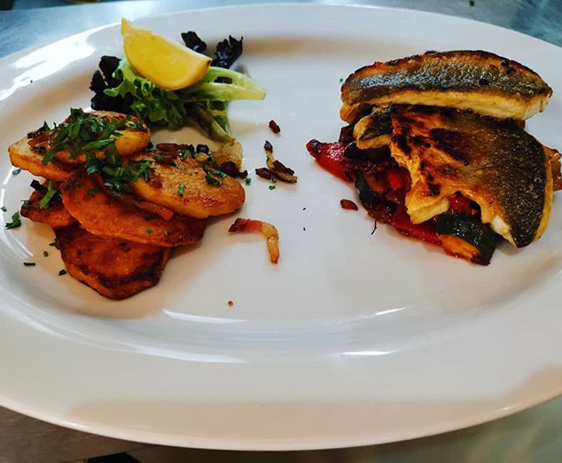 Grilled see bass served with soute potat