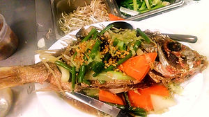 Fried whole fish in garlic sauce