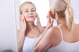 Forty years old woman looking at wrinkle