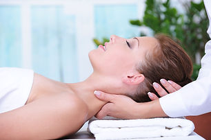 Neck massage for young woman relaxing in