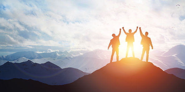 Silhouette of the team on the mountain. Leadership Concept.jpg