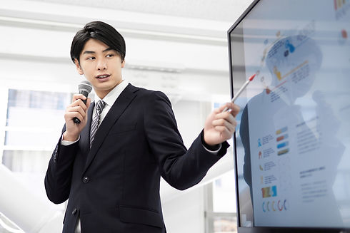A Japanese male businessman giving a presentation..jpg