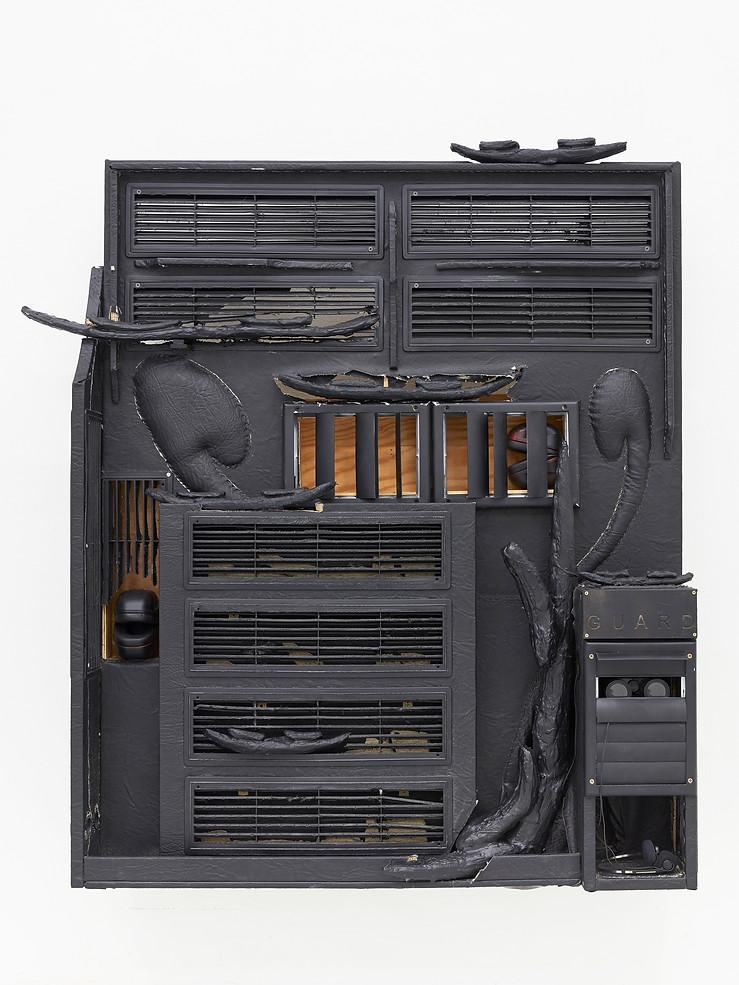 Untitled, 2020, plywood, pleather, upholstery foam, staples, ventilation elements, anti-noise ear muffs, binoculars, headphones, acrylic resin items.  Courtesy: Jan Kaps, Cologne