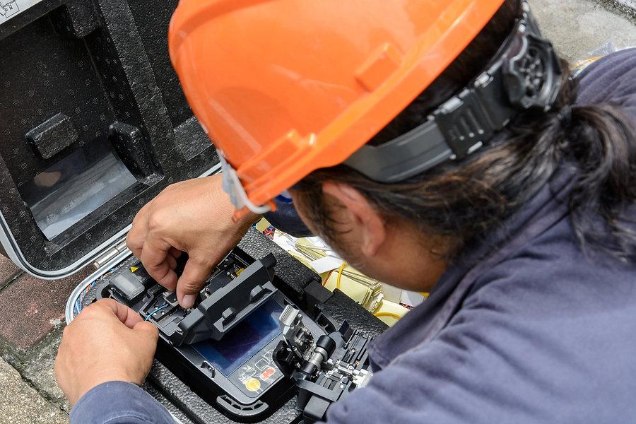 The technicians welding optical fiber ca