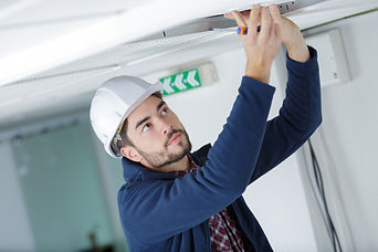 male electrician with screwdriver repair