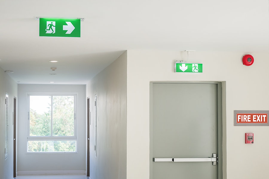 Fire exit sign with light on the path wa
