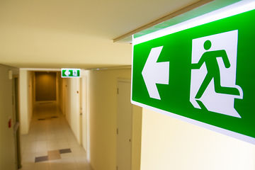Fire exit sign at  the corridor in build