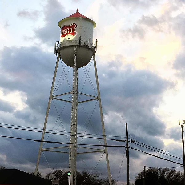 The Frisco Texas water tower in th evening.