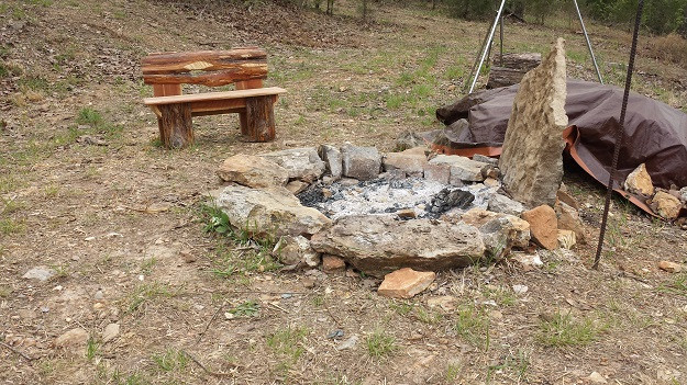 Fire pit with homemade children's wooden bench.