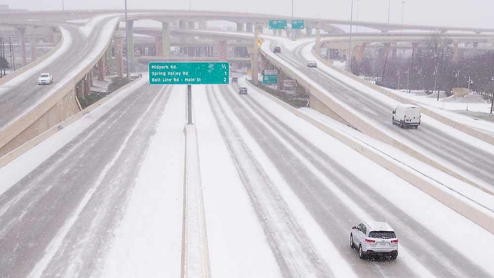 Snow covered interstate in Texas.