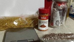 Packing dehydrated spaghetti with meat sauce into meals