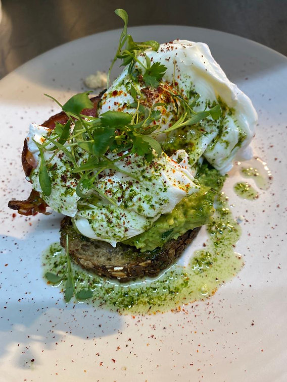 Poached eggs and avocado on sourdough wi