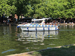A Waterways patrol boat taking part in the daily procession at Bedford River Festival.
