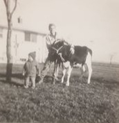John as a child with the family cow