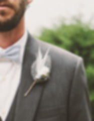 groom in grey tux with bow tie