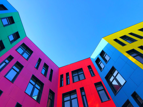 Multi-colored facades of the school with