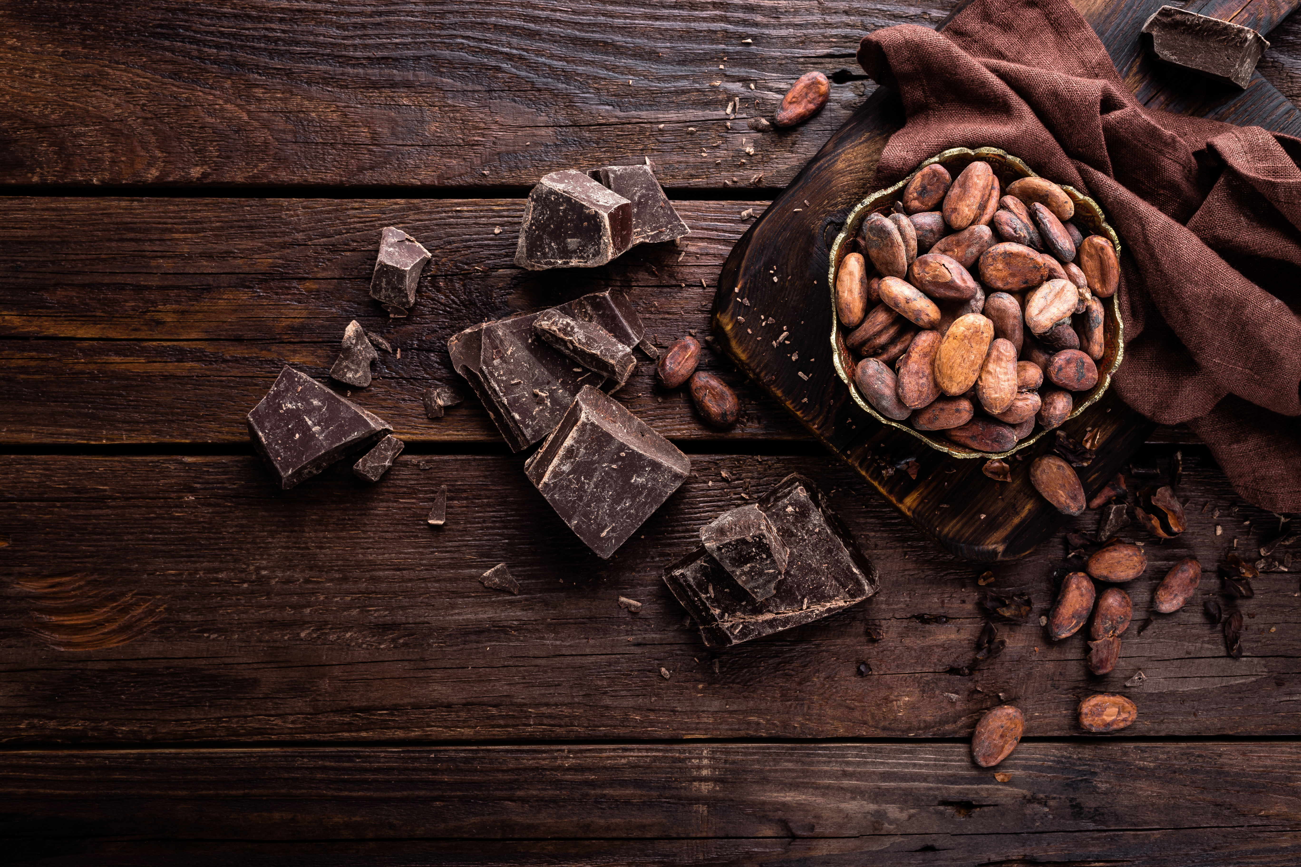 cocoa-beans-and-chocolate-on-wooden-back