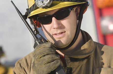 Portrait of a middle aged firefighter ha