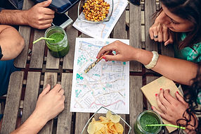 2495561-young-friends-looking-map-over-a