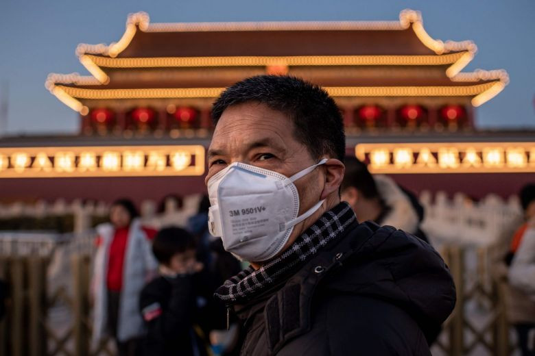 A man wearing a protective mask looks on as he walks past Tiananmen Gate in Beijing.PHOTO: AFP.  https://www.straitstimes.com