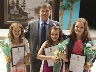 Hospital CEO speaks at Brookview Honor Society Induction & students present picture for display