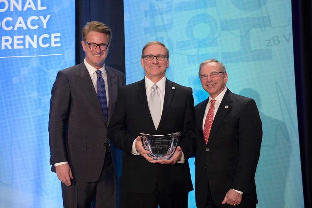Pictured: Ron Stollings, M.D., (center) a 1982 graduate of the Marshall University Joan C. Edwards School of Medicine, is pictured receiving the American Medical Association's 2016 Nathan Davis Award for Outstanding Public Service Award during a ceremony in Washington, D.C., on Tuesday, Feb. 23.