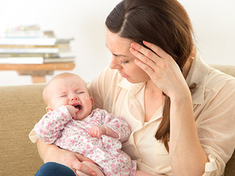 What is colic and how can baby massage help?