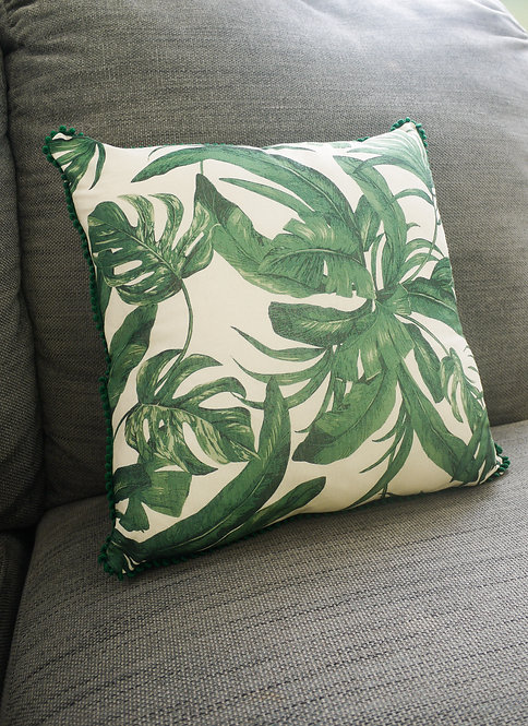 Tropical leaves with green pom pom trim - Upcycled handmade cushion