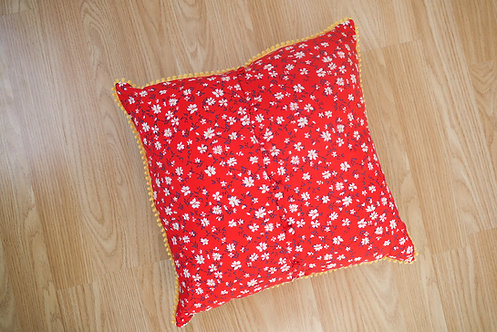 Floral on red, yellow pom pom trim all around, upcycled handmade cushion