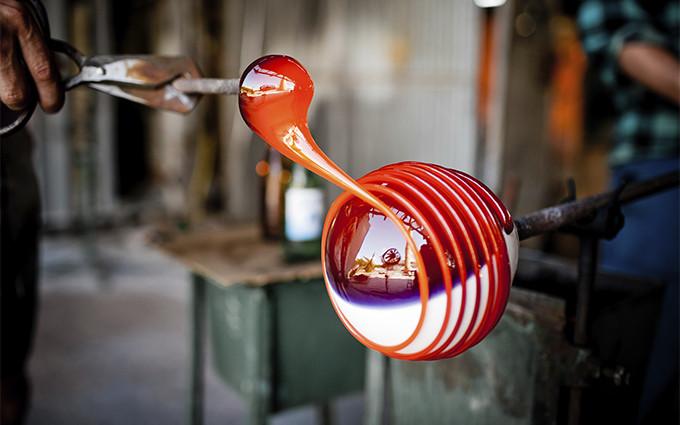 Man blowing glass art