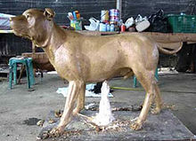Clay dog model in bronze statue lost-wax process