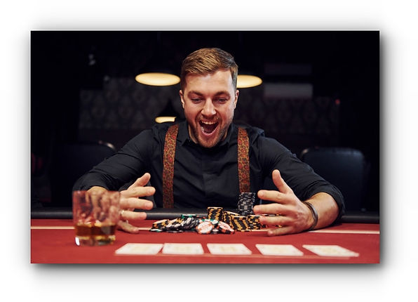 happy-elegant-young-man-sits-in-casino-a